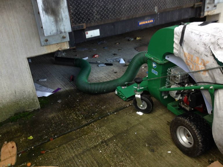 Cleaning under vehicle loading bays
